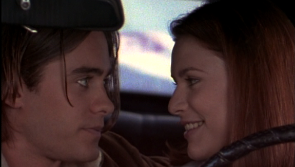 image of clare danes and jared leto in a car, smiling at each other