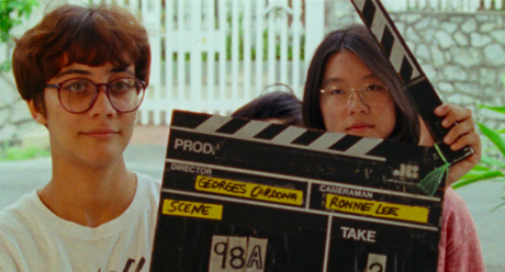 Sophia Siddique holds the slate in front of Sandi Tan;s face during the shooting of the original film Shirkers.