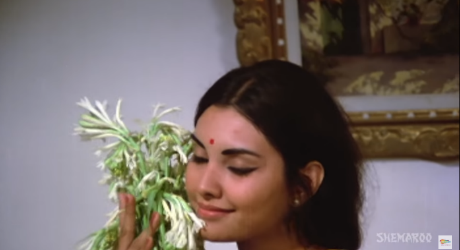 Deepa holds a bouquet of tuberoses to her face